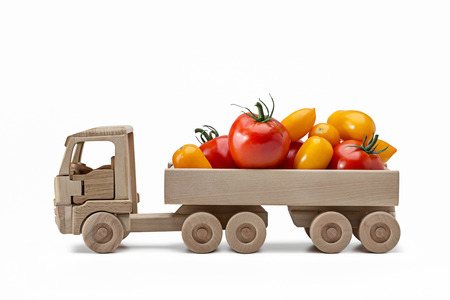 Mature red and yellow tomatoes in back of truck.