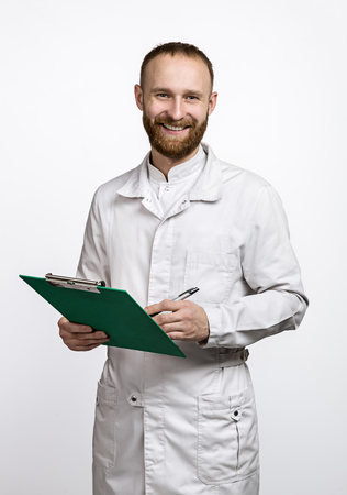 Young laughing doctor with folder and pen in white coat. Standard-Bild - 116492140
