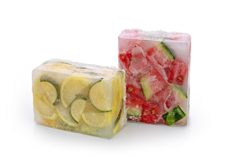 Frozen food concept: red watermelon slices, lemon and lime slices were frozen inside ice cubes. Standard-Bild - 116492142