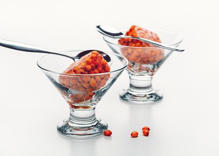 Dessert of frozen orange berries in glass bowl. Healthy food. Studio shot. Standard-Bild - 116492157