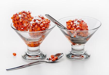 Dessert of frozen orange berries in glass bowl. Healthy food. Studio shot. Standard-Bild - 116492158