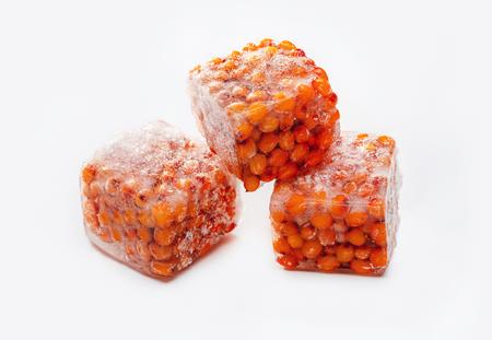 Frozen yellow sea buckthorn berries in ice cubes. Healthy food. Studio shot. Standard-Bild - 116492163