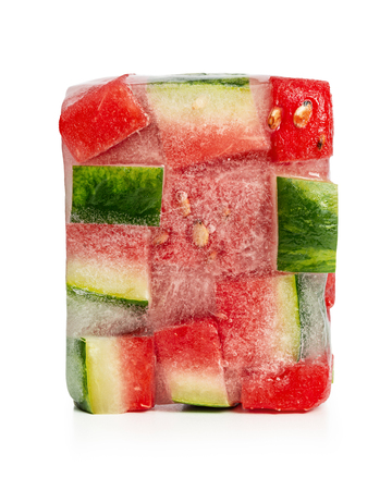 Frozen, in ice cube, slices of red watermelon on white background. Studio shot. Standard-Bild - 116492193