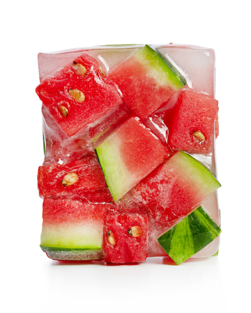 Frozen, in ice cube, slices of red watermelon on white background. Studio shot Standard-Bild - 116492204