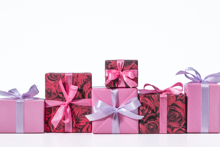 Holiday boxes. Gift in box. Multicolored ribbons. Boxes in row. Celebration. Happy Holidays. Copy space. Фото со стока