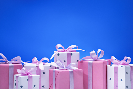 Gift boxes on blue background concept for holidays and greeting cards.