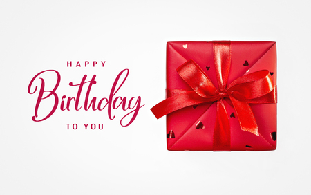 One red box with surprise for any occasion.Gift in box. Birthday. Concept of gifts. Close-up. Фото со стока
