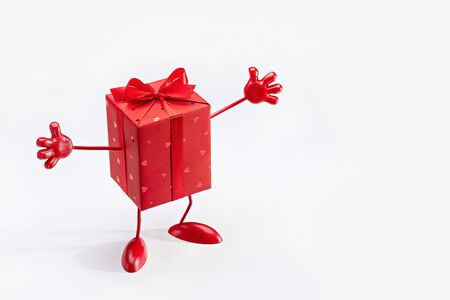 Gift in box. Red box on legs, with hands. Cartoon figure. Copy space.