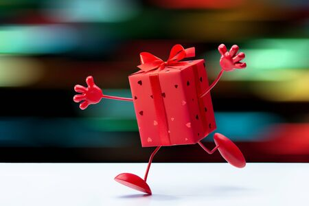 I am your gift! Cheerful gift in red box. Unexpected congratulations. Bright background.