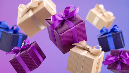 Gifts in flying boxes wrapped in blue, purple and craft paper with bow on bright background. Holidays and greeting card concept.