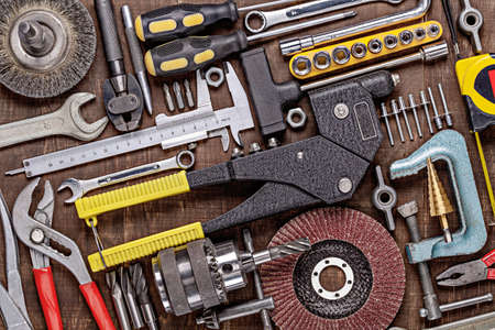 A set of working tools for homework. Background of household tools. Equipment for repair and construction.