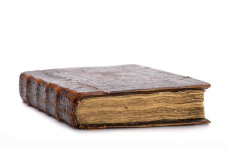 An ancient book in shabby, brown cover on white background, isolated. 版權商用圖片