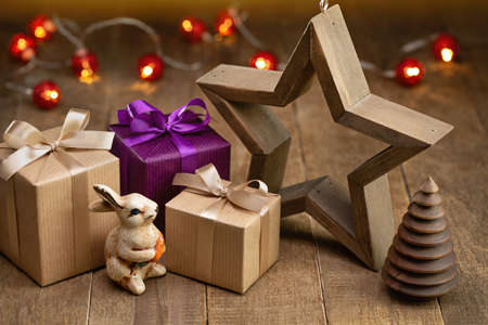 Christmas background. Surprises in fancy boxes, rabbit and holiday lights in the background. Happy Holidays. 版權商用圖片
