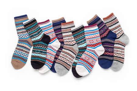 Set of socks isolated on white background. Composition of multi-colored socks. Unisex socks. Socks background. 版權商用圖片