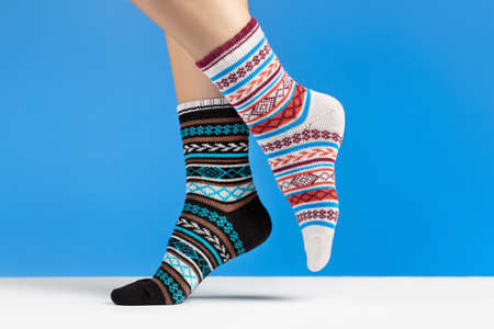 Close-up of colorful soft socks. Female legs comfort and relaxation concept