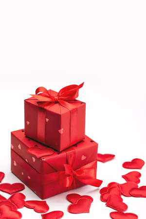Valentine's day, holiday concept. Gift box and red hearts on a light background. Symbols of love, greeting card design.