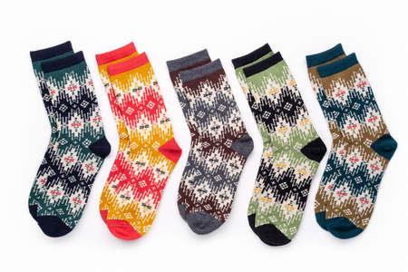 Set of socks isolated on white background. Composition of multi-colored socks. Children's socks. Socks background. 版權商用圖片