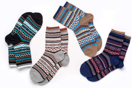 Composition of multi-colored socks with an ornament for sports and leisure in cold weather. 版權商用圖片 - 158397470