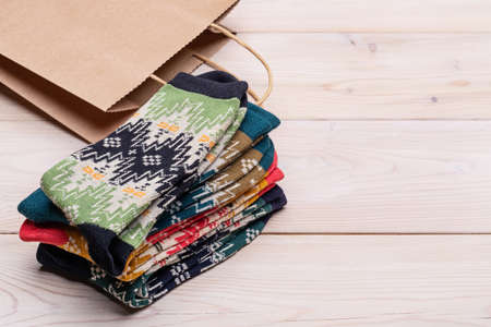 Knitted socks, craft paper gift bag. Cute gift or decoration for Christmas celebration. 版權商用圖片 - 158397643