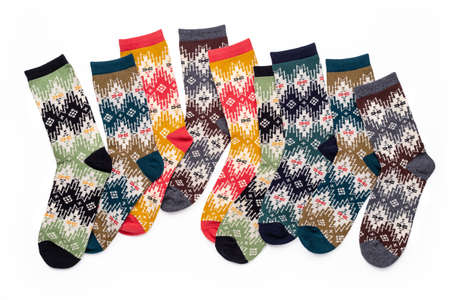 Collection of multicolored knitted socks with bright festive ornament. 版權商用圖片 - 158397649