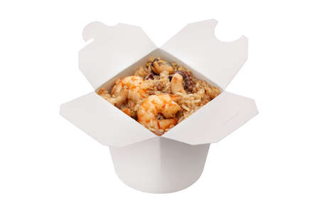 Ready-made food. Chinese cuisine. Wheat noodles with seafood. White background. Copy space, isolated.