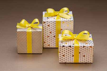 Gifts in three boxes wrapped in decorative paper with pictures. A surprise for any holiday and event.