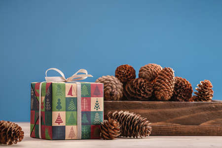 Pine cones, Christmas and New Year gifts, packed in boxes with winter ornament. The concept of gifts and souvenirs for loved ones.