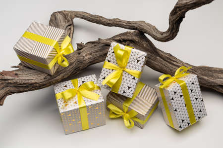 A set of gifts, smartly wrapped, in boxes on snag. Various holidays and events. 版權商用圖片