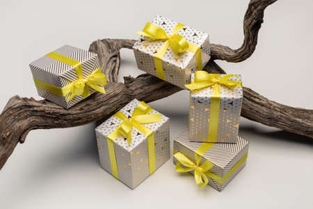 Gifts in beautifully packed boxes. Surprises for various holidays and events, close-up.