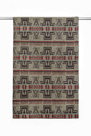 Brown textile background from woolen throw blanket, with geometric pattern, close-up, isolated on white Standard-Bild