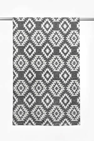 Textile background from woolen throw blanket, with geometric pattern, close-up, isolated on white