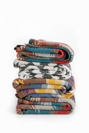 Several luxurious multi-colored throw wool blanket. Elegant textile background in Pendelton style. Standard-Bild