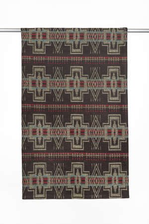 Textile background with geometric pattern from woolen throw blanket, close-up, isolated on white