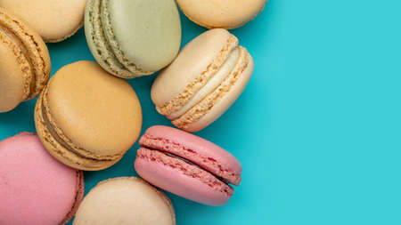 Background from multicolored macaroons on bright blue background top view copy space Backgrounds and textures Standard-Bild