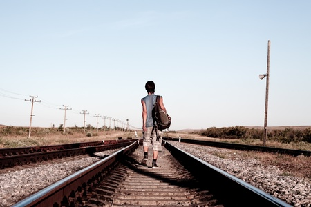 abandonment: Teen boy with problem walking on railroad