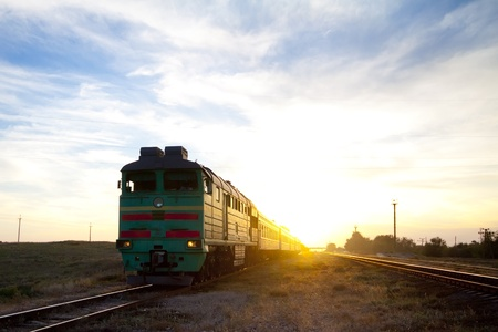 Train locomotive traveling during sunset