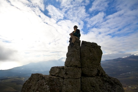 woman on top of the mountain reaches for the sun photo
