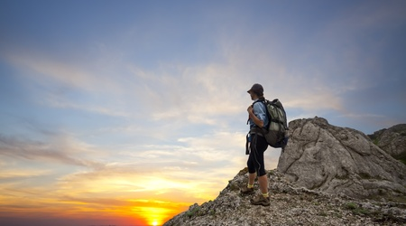 woman trekking in mountains photo