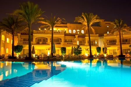 Night pool side of rich hotel