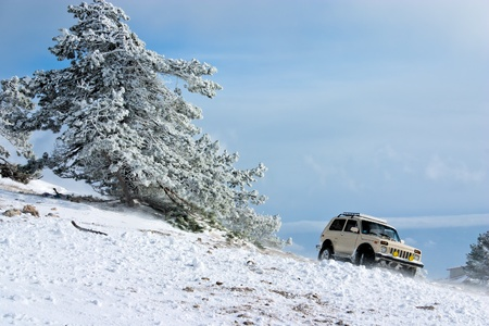 Off-road car on winter landscape photo