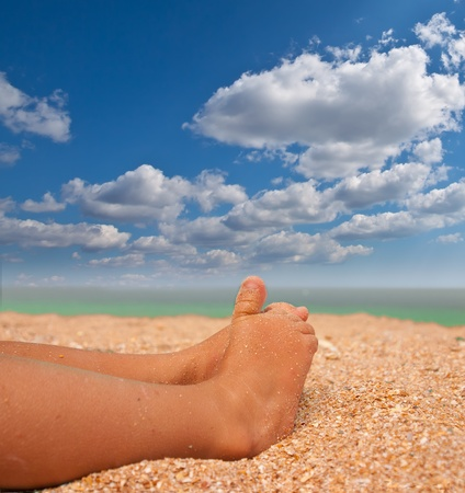 Sweet feet on the beach Stock Photo - 12409535