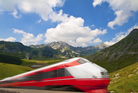 Fast train passing by mountain landscape photo