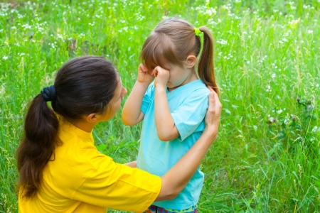 Young mother has conversations with daughter of preschool age Stock Photo