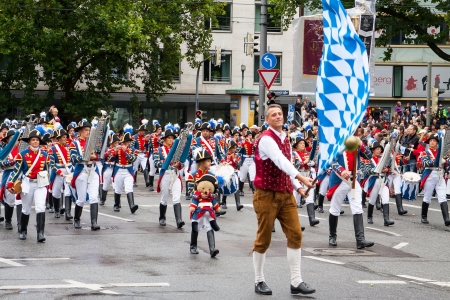 tracht: MUNICH - SEPTEMBER 22: musicians dressed in national costumes take part into Oktoberfest solemn procession September 22, 2012 in Munich, Bavaria, Germany.  Editorial