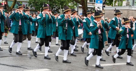 tracht: MUNICH, BAVARIA, GERMANY  2012 September 22 musicians dressed in national costumes take part into Oktoberfest solemn procession. Oktoberfest is annually beer festival. Editorial