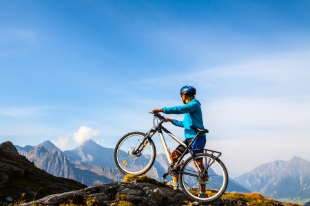 Mountain biking - woman on bike, Dolomites, Italy photo