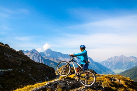 Mountain biking - woman on bike, Dolomites, Italy Standard-Bild