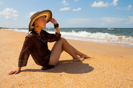 Girl in brown on summer sea beach Stock Photo - 18577924
