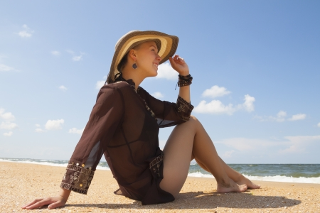 Girl in brown on summer sea beach Stock Photo - 18577923