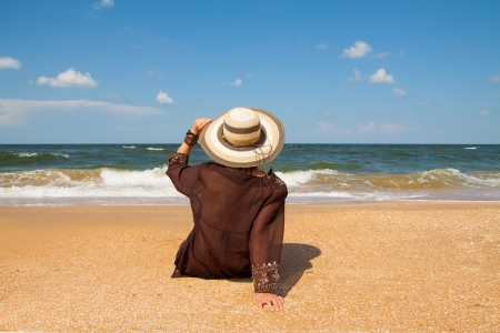 Girl in brown on summer sea beach Stock Photo - 18577928